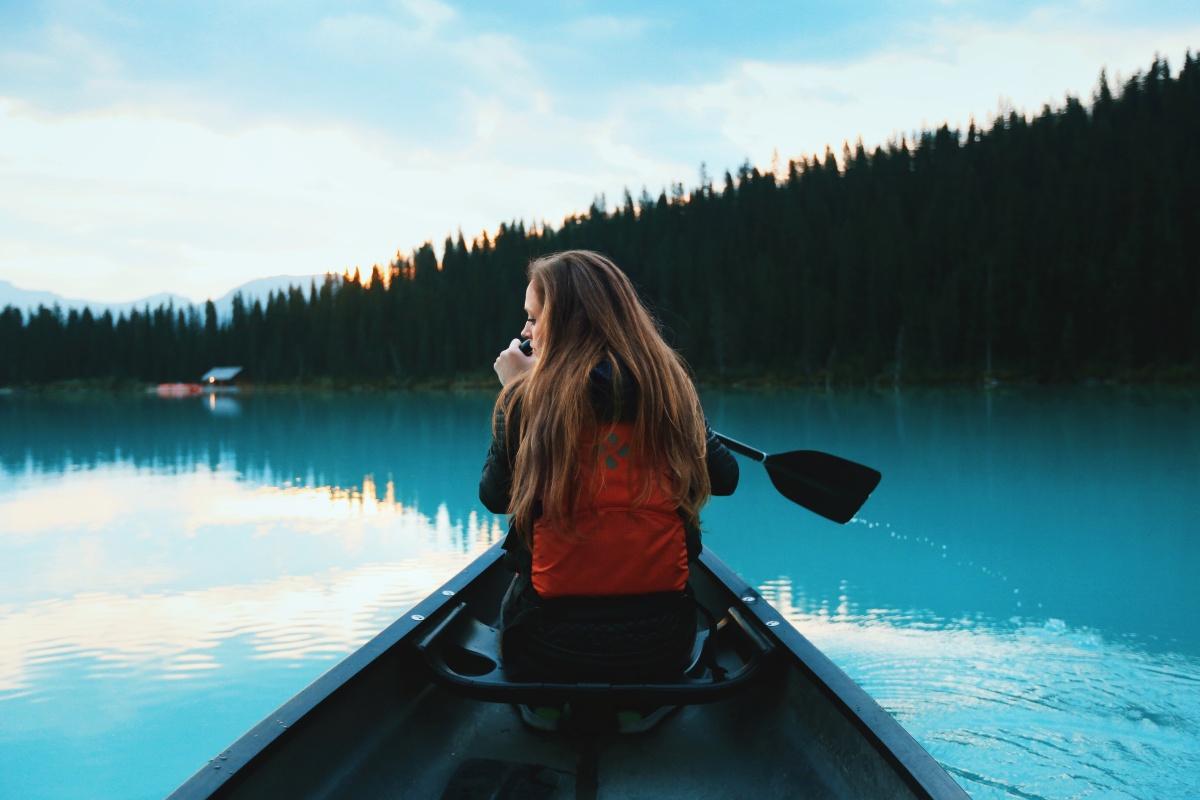 Woman canoeing on a mountain lake