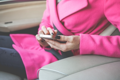 Stylish woman scrolling on an iphone
