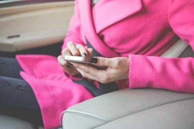Stylish woman scrolling on an iphone
